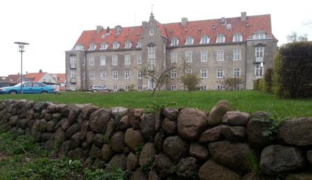 Asylansøger erkendte trusler mod leder på Slottet